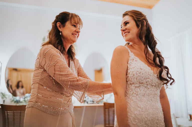 Tampa Bride Getting Ready Wedding Portrait with Mom Wearing Lace and Illusion V Neckline Fitted Wedding Dress