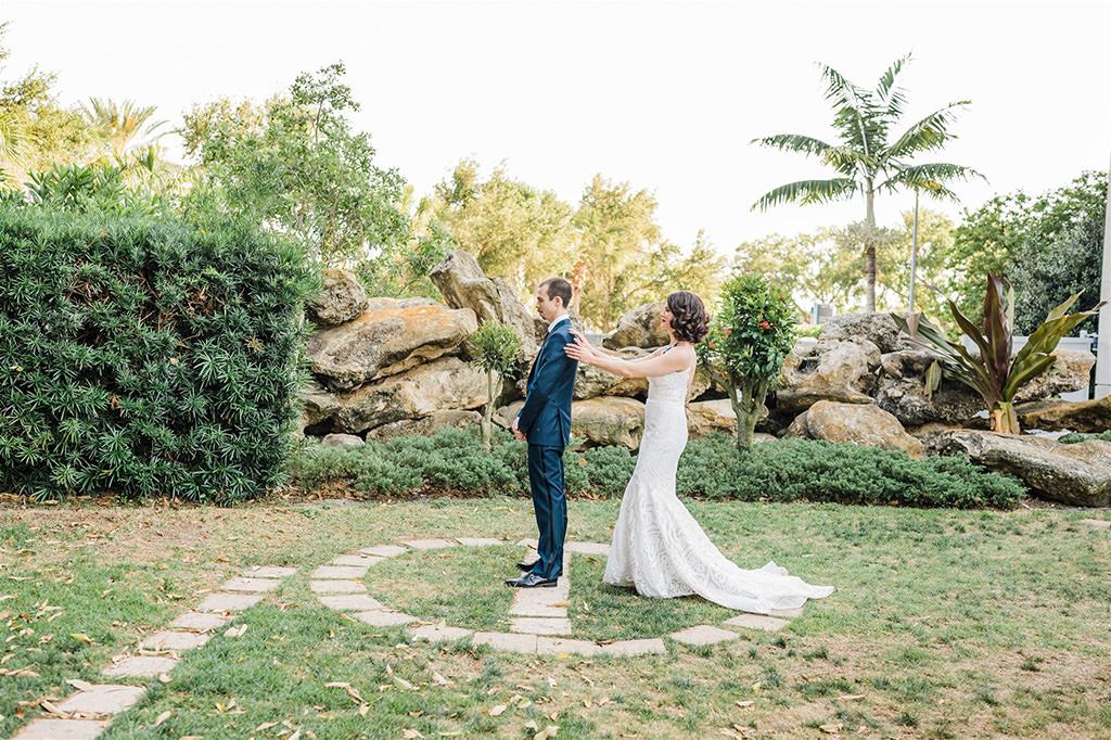 Outdoor Garden Florida Bride and Groom First Look Wedding Portrait | St. Petersburg Unique Wedding Venue Salvador Dali Museum