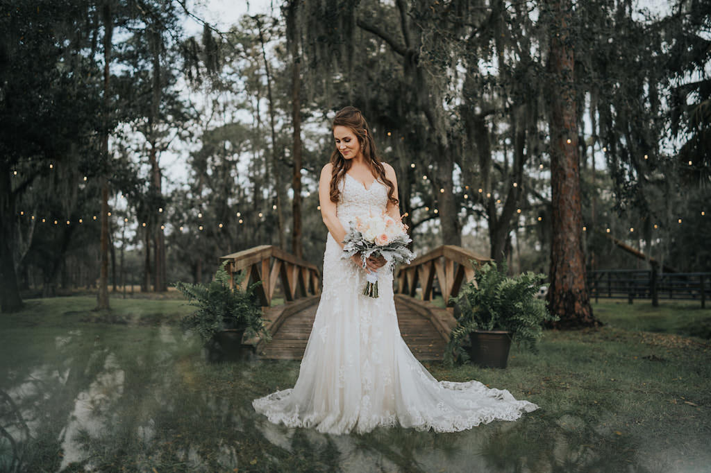 Rustic Chic Tampa Bay Bride Beauty Outdoor Wedding Portrait Wearing Lace and Illusion Fitted V Neckline Romantic Wedding Dress Holding Blush Pink and White Roses and Dusty Miller Bridal Floral Bouquet   Parrish Barn Wedding Venue Rafter J Ranch