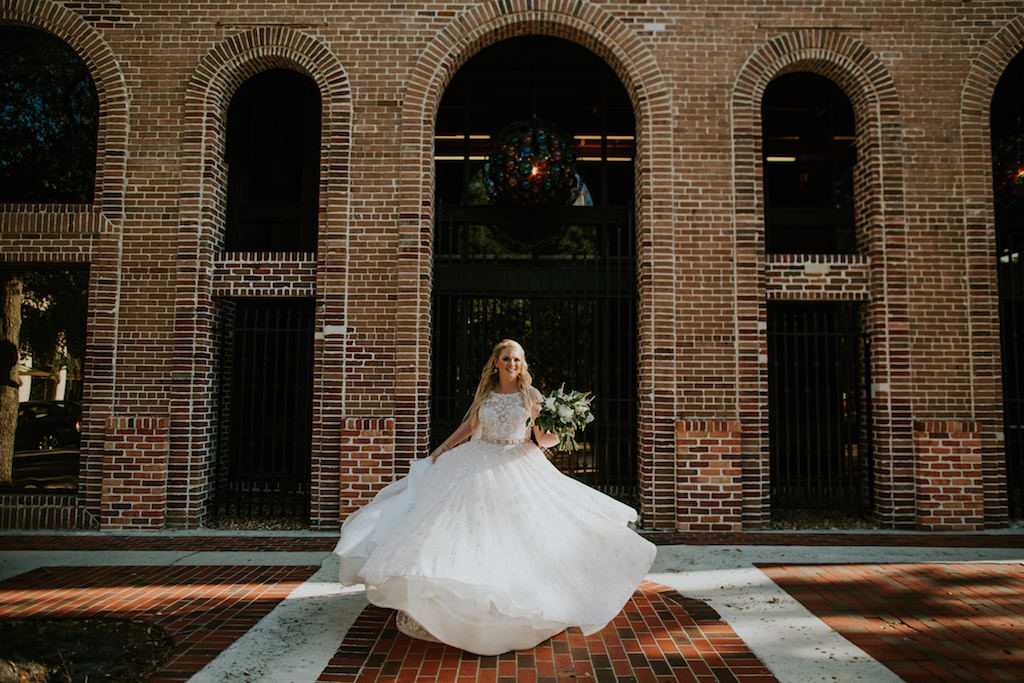 Tampa Bay Bride Twirling in High Neck Halter Lace and Illusion Wedding Dress