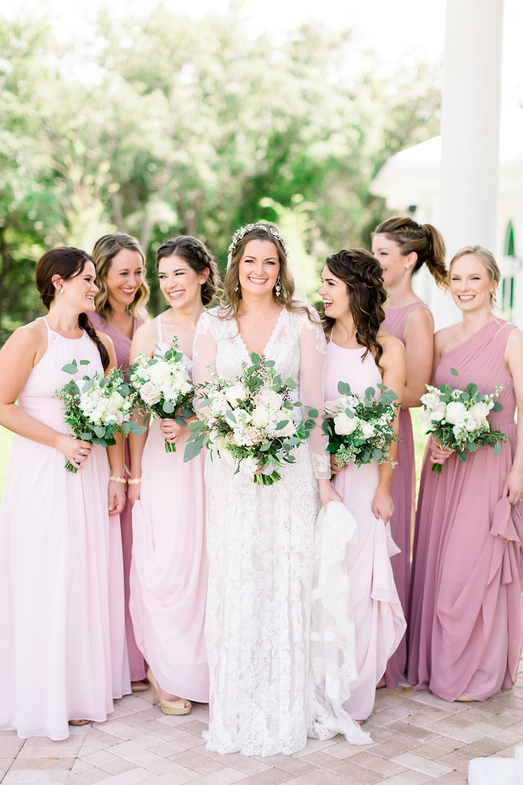 Florida Boho Inspired Bride and Bridesmaids Portrait, Wearing Mix and Match Blush, Pink Long Dresses, Holding White Floral Bouquets with Greenery | Tampa Bay Wedding Photographers Shauna and Jordon Photography | Tampa Wedding Hair and Makeup Artist Femme Akoi Beauty Studio