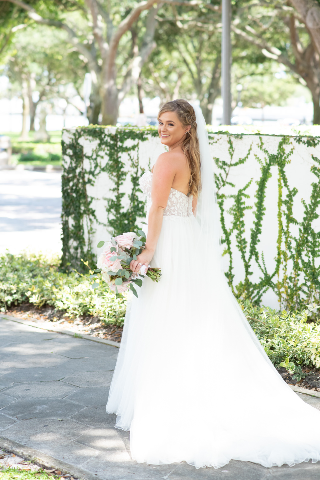 Classic Florida Bride Outdoor Wedding Portrait with Blush Pink Floral and Greenery Floral Bouquet Wearing A-Line Justin Alexander Floral Embellished Bodice Sweetheart Strapless Tulle Skirt Wedding Dress   Tampa Bay Wedding Planner Coastal Coordinating   St. Pete Boutique Hotel and Wedding Venue The Birchwood