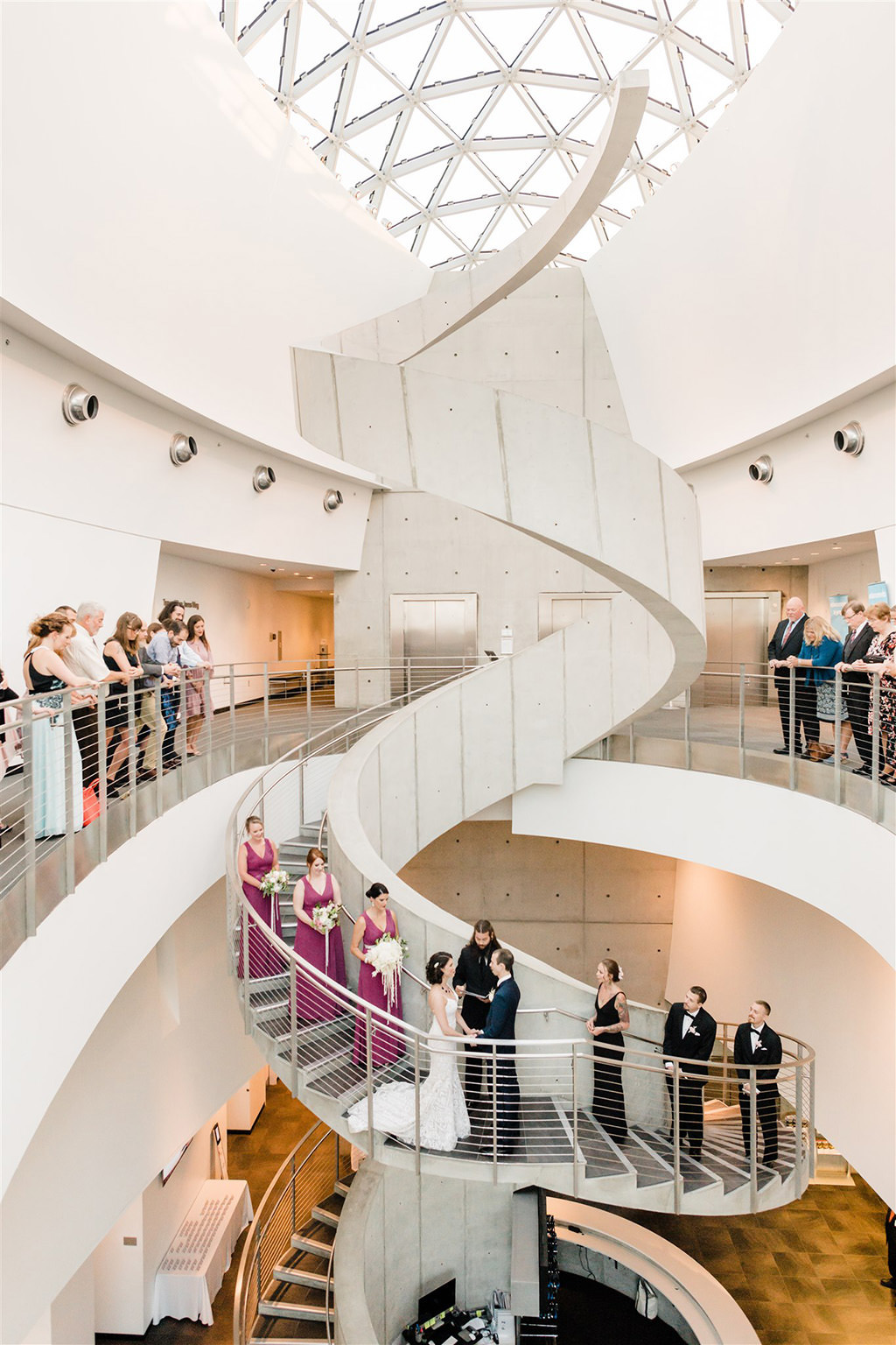 Florida Bride and Groom Exchanging Wedding Ceremony Vows on White Spiral Staircase at Unique St. Petersburg Salvador Dali Museum Venue