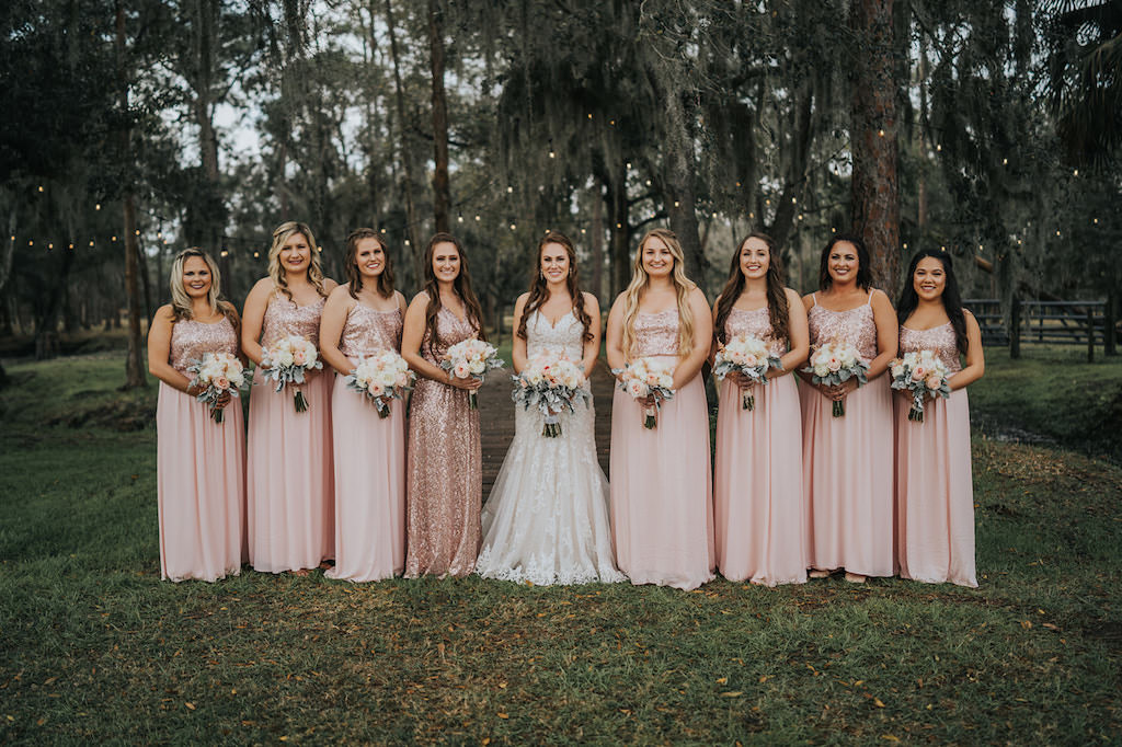 Tampa Bay Bride in Lace and Illusion V Neckline Wedding Dress, Bridesmaids in Blush Pink Sparkle Glitter Sequin Bodice Dresses Holding White and Pink Roses with Dusty Miller Leaves   Parrish Wedding Venue Rafter J Ranch