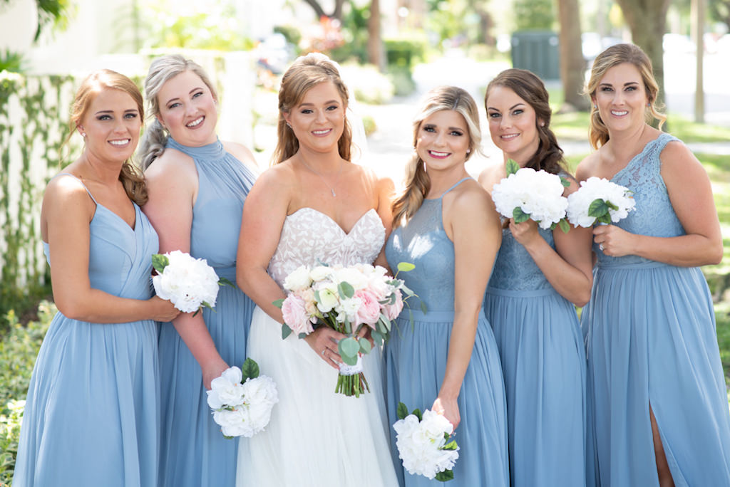 Classic Florida Bride and Bridal Party Wedding Portrait, Bridesmaids Holding Simple White Floral Bouquets, Wearing Mix And Match Dusty Blue Long Azazie Dresses, Bride in Strapless Sweetheart A-Line Justin Alexander Wedding Dress with Blush Pink and Ivory Floral Bouquet and Greenery   Tampa Bay Wedding Planner Coastal Coordinating