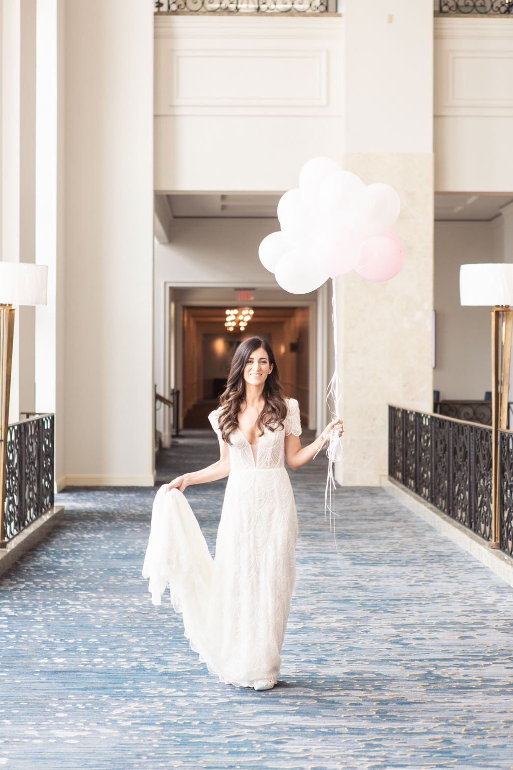 Classic Tampa Bride Wedding Beauty Portrait Holding Pink Balloons in Delicate Cap Sleeve V Neckline Wedding Dress   Wedding Hair and Makeup Femme Akoi