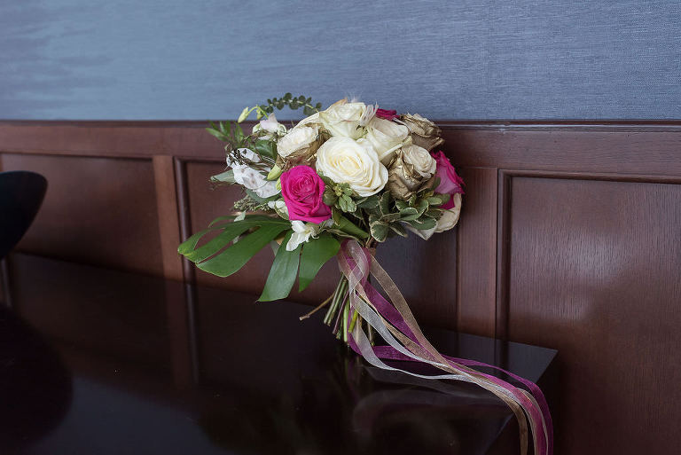 Tropical Elegeant Bridal Wedding Floral Bouquet with Monsterra Leaf and Cream, Magenta, and Gold Roses with Greenery and Satin Ribbons | Tampa Bay Wedding Florist Brides N Blooms Wholesale and Design