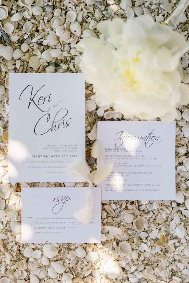 White Invitation Suite with Black Script Design with Seashells Portrait