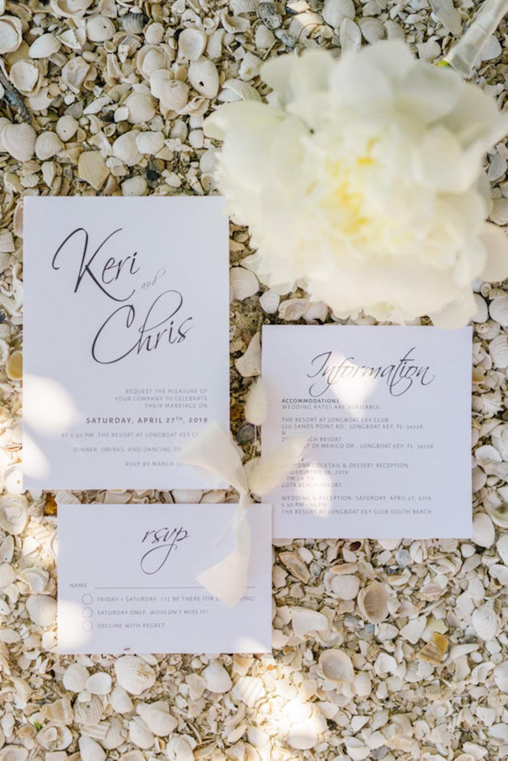 White Invitation Suite with Black Script Design with Seashells Portrait
