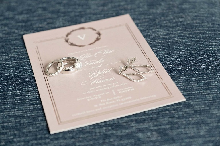Classic Dusty Rose Wedding Invitation with Bridal Details, Teardrop Earrings, Solitaire Engagement Ring with Wedding Band.
