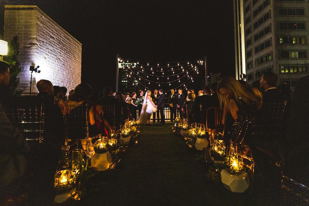 INSTAGRAM Nighttime Rooftop Wedding Ceremony Portrait, Bride and Groom Exchanging Vows Under String Lights | St. Petersburg Wedding Venue Station House