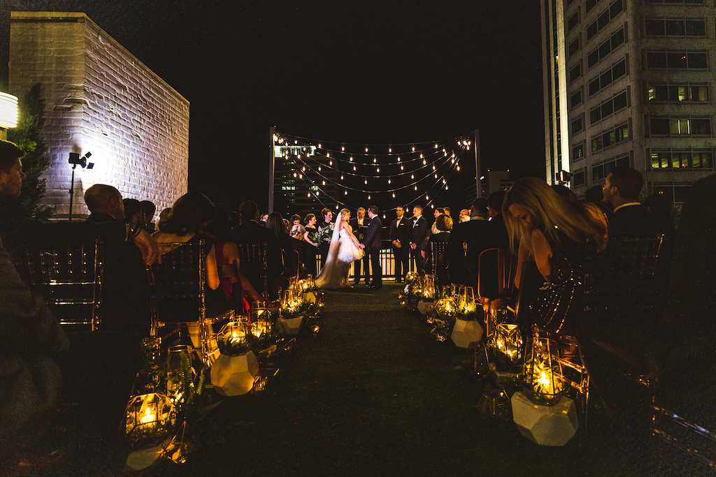 INSTAGRAM Nighttime Rooftop Wedding Ceremony Portrait, Bride and Groom Exchanging Vows Under String Lights   St. Petersburg Wedding Venue Station House