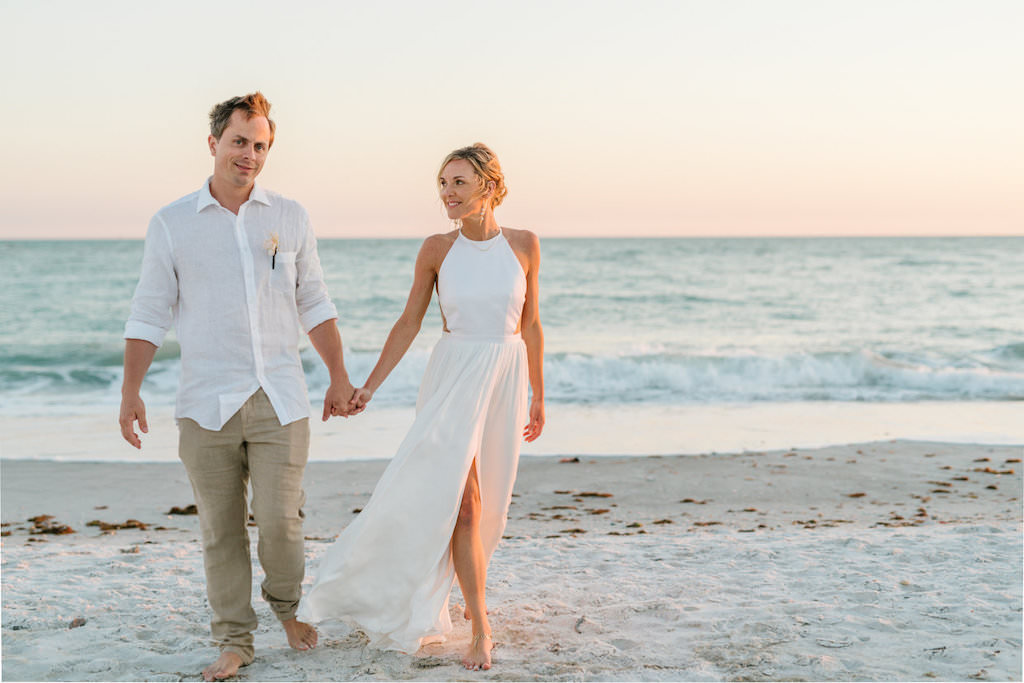 Florida Destination Bride and Groom Beachfront Casual Wedding Attire Walking Barefoot in the Sand | Resort at Longboat Key Club
