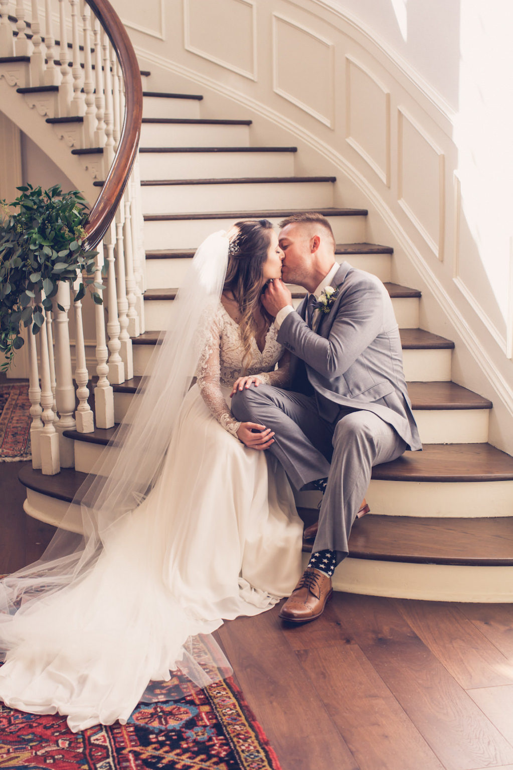 Simple Chic Romantic, South Tampa Bride and Groom Wedding Portrait on Staircase, Bride with Cathedral Length Veil | Wedding Venue Tampa Yacht Club | Florida Luxury Wedding Photographer Luxe Light Images
