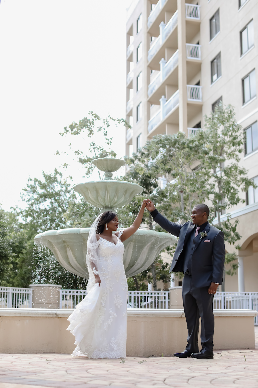 Florida Bride and Groom Outdoor Fountain Wedding Portrait | Tampa Wedding Photographer Lifelong Photography Studio | Wedding Dress Boutique Truly Forever Bridal | Largo Wedding Venue Bayou Club