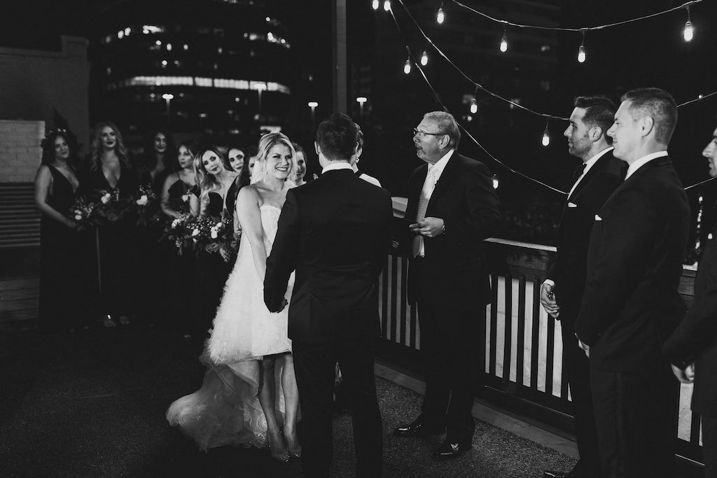 Romantic Modern Bride and Groom Exchanging Vows Wedding Ceremony Portrait   Rooftop St. Pete Wedding Venue Station House