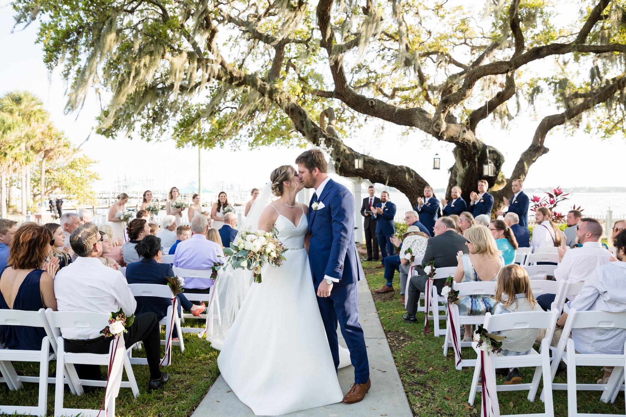 Tampa Bay Classic Bride and Groom Kiss Recessional Wedding Portrait   Waterfront Outdoor Wedding Venue Palmetto Riverside Bed and Breakfast   Wedding Planner Coastal Coordinator