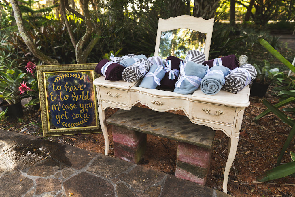Boho Chic Tampa Wedding Ceremony Decor Antique Off White Vanity With Blankets Gold Mirror Frame Wedding Sign To Have And To Hold In Case You Get Cold Marry Me Tampa Bay