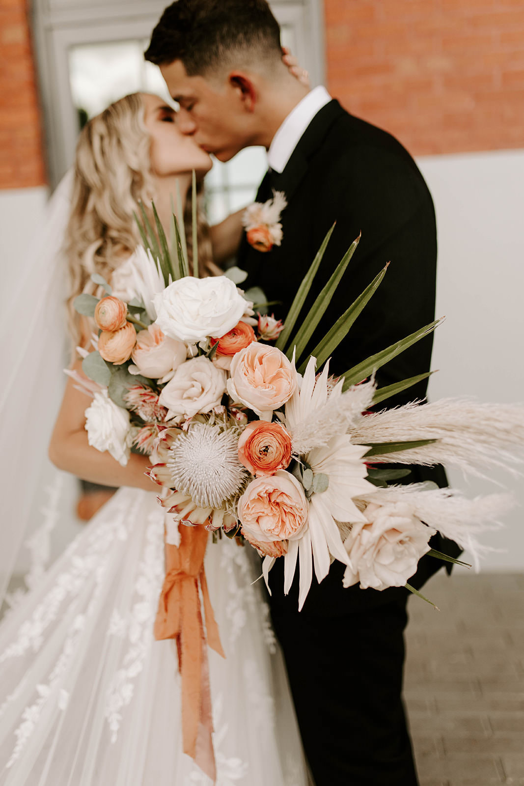 Boho Bride and Groom Intimate Creative Wedding Portrait, Bride Holding Whimsical Palm Tree Leaves, White Feathers, Burnt Orange and Blush Pink Roses, King Protea, Eucalyptus Leaves Floral Bouquet   Tampa Bay Wedding Planner Coastal Coordinating