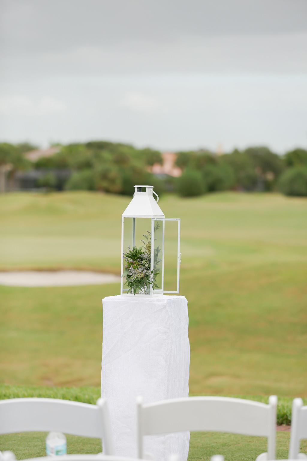 Outdoor Wedding Ceremony Lantern Decor with Greenery | Tampa Bay Golf Course Wedding Venue The Bayou Club | Tampa Wedding Photographer Lifelong Photography Studio