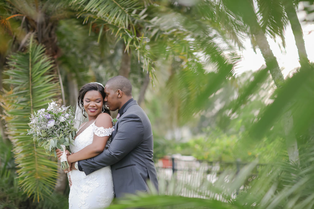 Outdoor Bride and Groom Tropical Inspired Wedding Portrait | Truly Forever Bridal Tampa Wedding Dress | Tampa Hair and Makeup Michele Renee the Studio | Tampa Wedding Photographer Lifelong Photography Studio | The Bayou Club