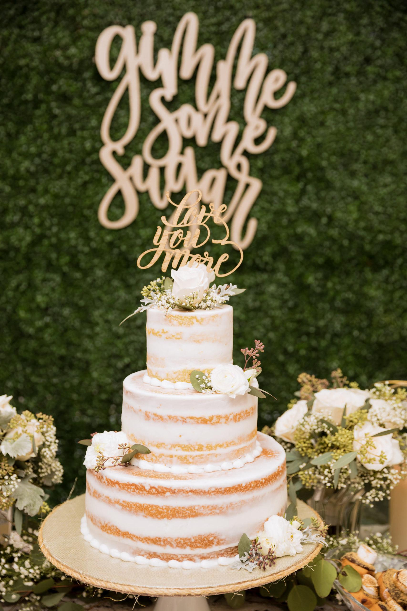 Rustic Elegant Semi Naked Three Tier Wedding Cake Garnished with White Roses   Tampa Bay Wedding Planner Coastal Coordinating