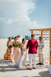 Tropical Beachfront Bride and Groom Exchanging Wedding Vows During Wedding Ceremony Portrait | St. Pete Wedding Venue Postcard Inn on the Beach