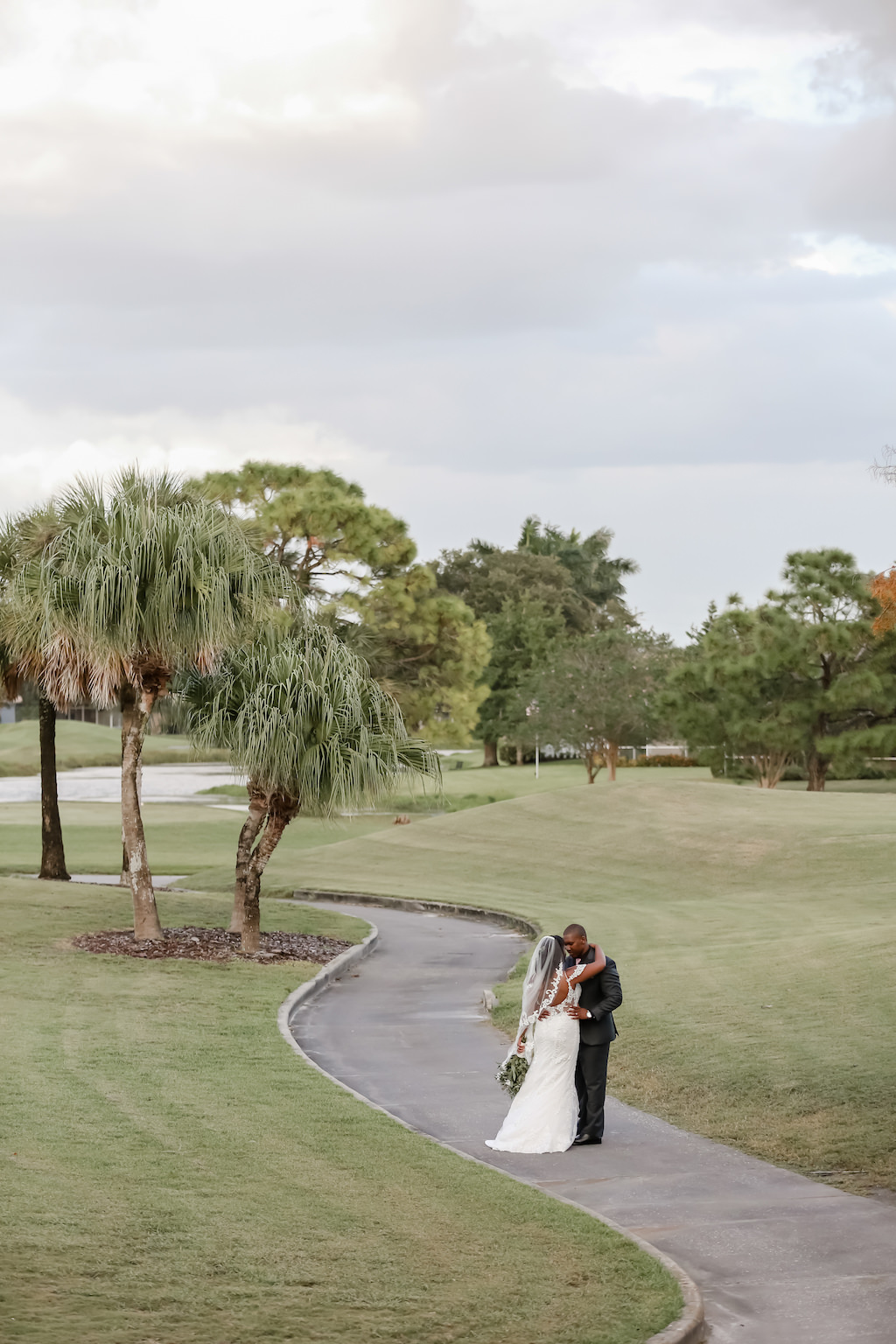 Outdoor Golf Course Bride and Groom Wedding Portrait | Tampa Bay Golf Course Wedding Venue The Bayou Club | Tampa Wedding Photographer Lifelong Photography Studio