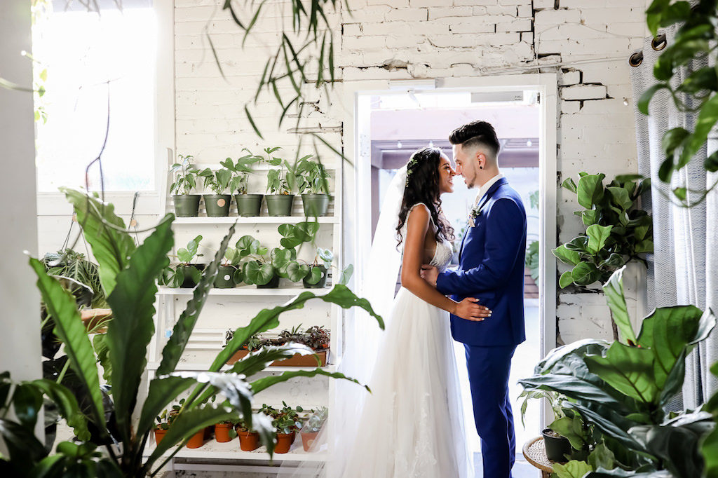 Romantic Bride and Groom Wedding Portrait in Plant Nursery | Tampa Bay Wedding Photographer Lifelong Photography Studio | Unique Wedding Ceremony Venue Fancy Free Nursery
