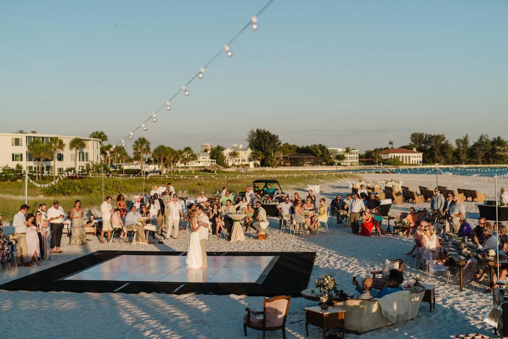 Outdoor Sarasota Beachfront Wedding Reception on the Sand | Sarasota Beachfront Bride and Groom Barefoot First Dance Wedding Portrait | Resort at Longboat Key Club Waterfront Beach Wedding Venue