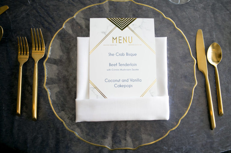 Glass Gold Rimmed Charger Plate and Gold Flatware with Gold Foil White Marble Menu Stationery | Tampa Wedding Rentals Kate Ryan Event Rentals | Wedding Planner John Campbell Weddings | Wedding Photographer Carrie Wildes Photography