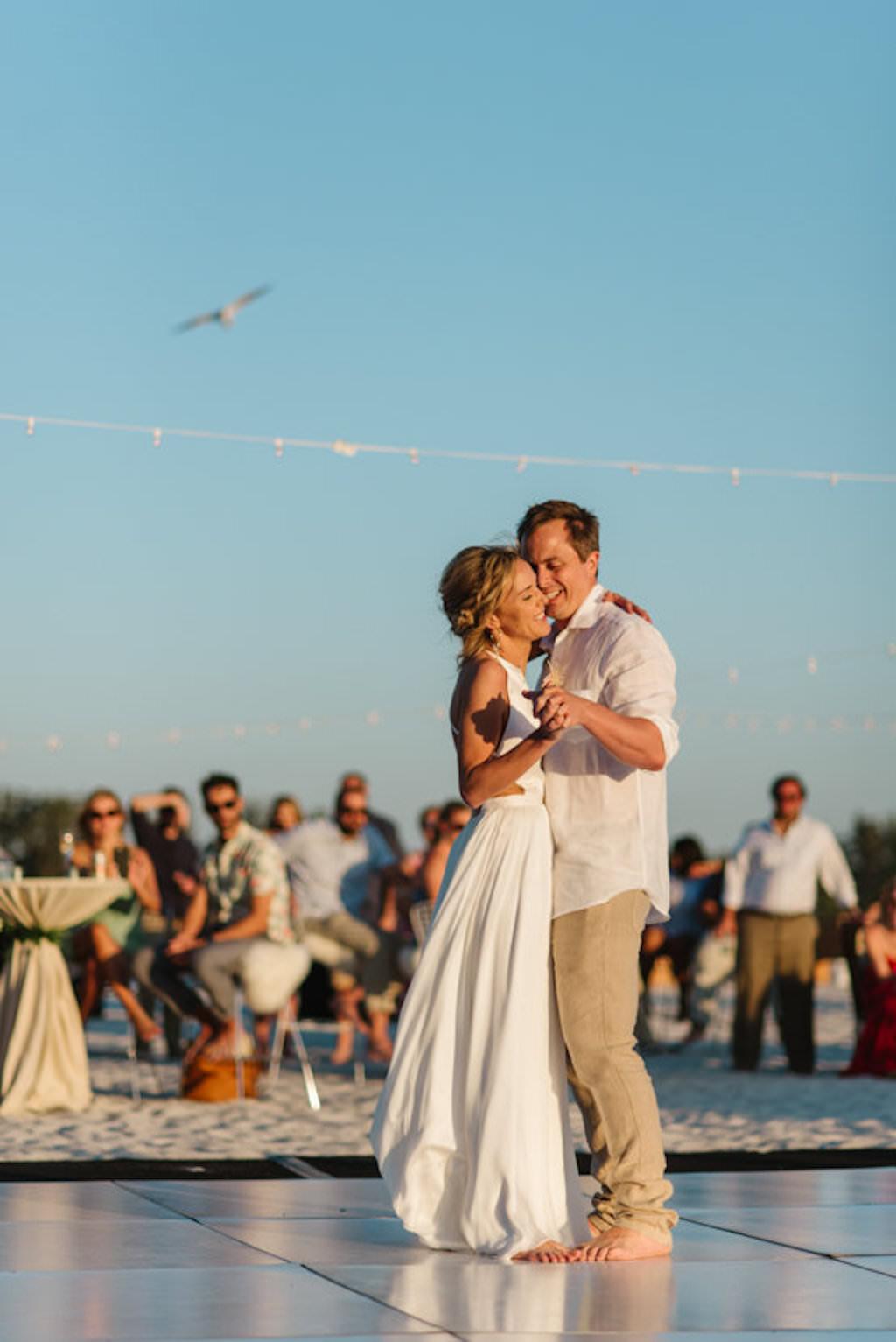 Sarasota Beachfront Bride and Groom Barefoot First Dance Wedding Portrait | Resort at Longboat Key Club Waterfront Beach Wedding Venue