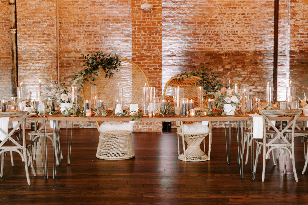 INSTAGRAM Boho Whimsical Wedding Reception Decor, Long Feasting Table with Tall Hurricane Glass Candle Vases, Palm Fronds and White, Blush Pink and Burnt Orange Floral Arrangments, Wicker Dome Mr and Mrs Chairs | Tampa Bay Wedding Planner Coastal Coordinating | Industrial Wedding Venue Armature Works