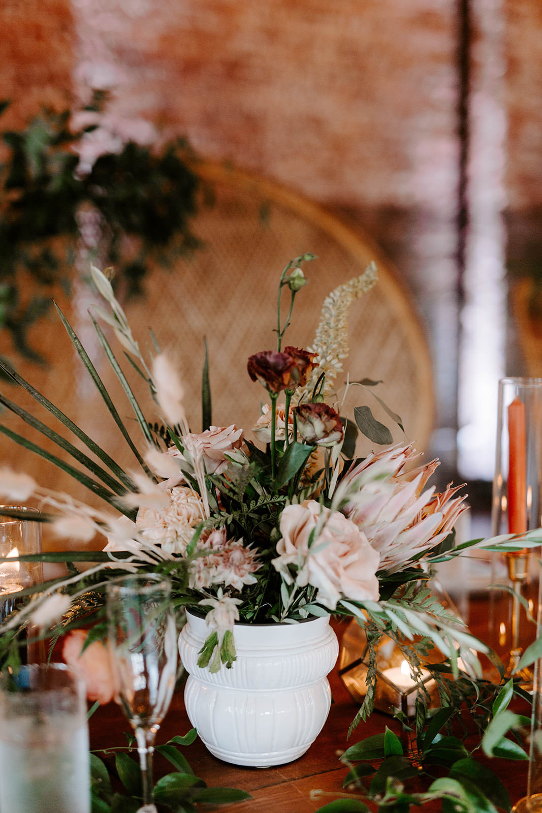 Boho Whimsical Wedding Reception Decor, Small White Vase with Palm Fronds, Blush Pink Roses, King Protea Floral Centerpiece   Tampa Bay Wedding Planner Coastal Coordinating