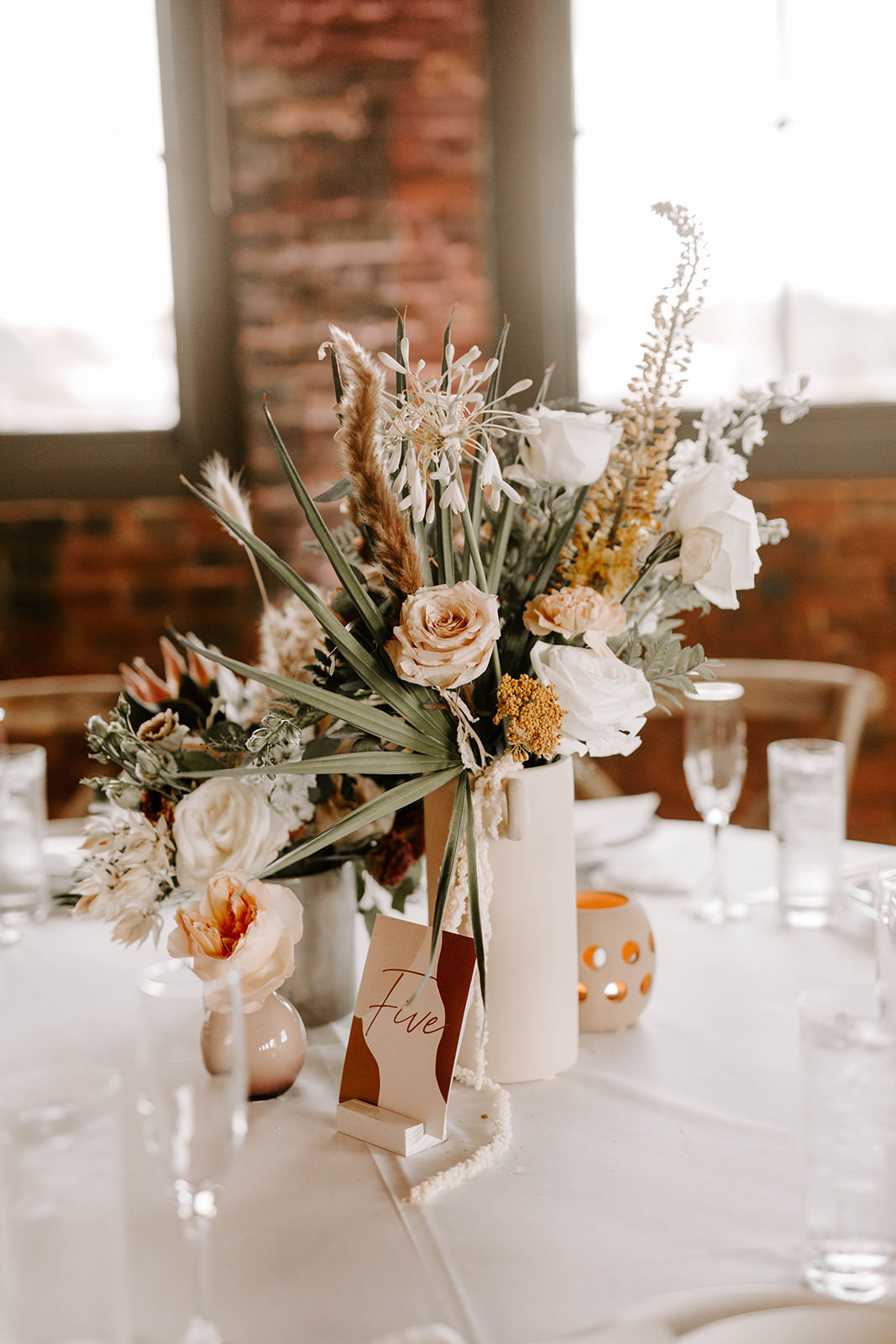 Boho Whimsical Wedding Reception Decor, Small White Vase with White and Blush Pink Roses, Palm Fronds Floral Centerpiece   Tampa Bay Wedding Planner Coastal Coordinating