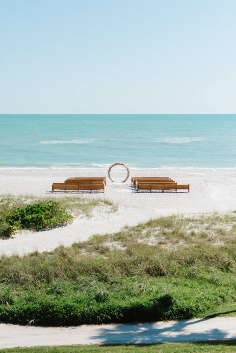 Longboat Key Club Beachfront Wedding Ceremony with Wooden Pews | Resort at Longboat Key Club Waterfront Beach Wedding Venue