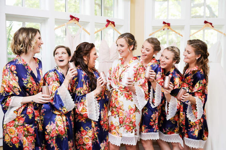 Tampa Bay Bride and Bridesmaids in Navy Blue Floral Robes Fun Cheers Getting Ready Wedding Portrait