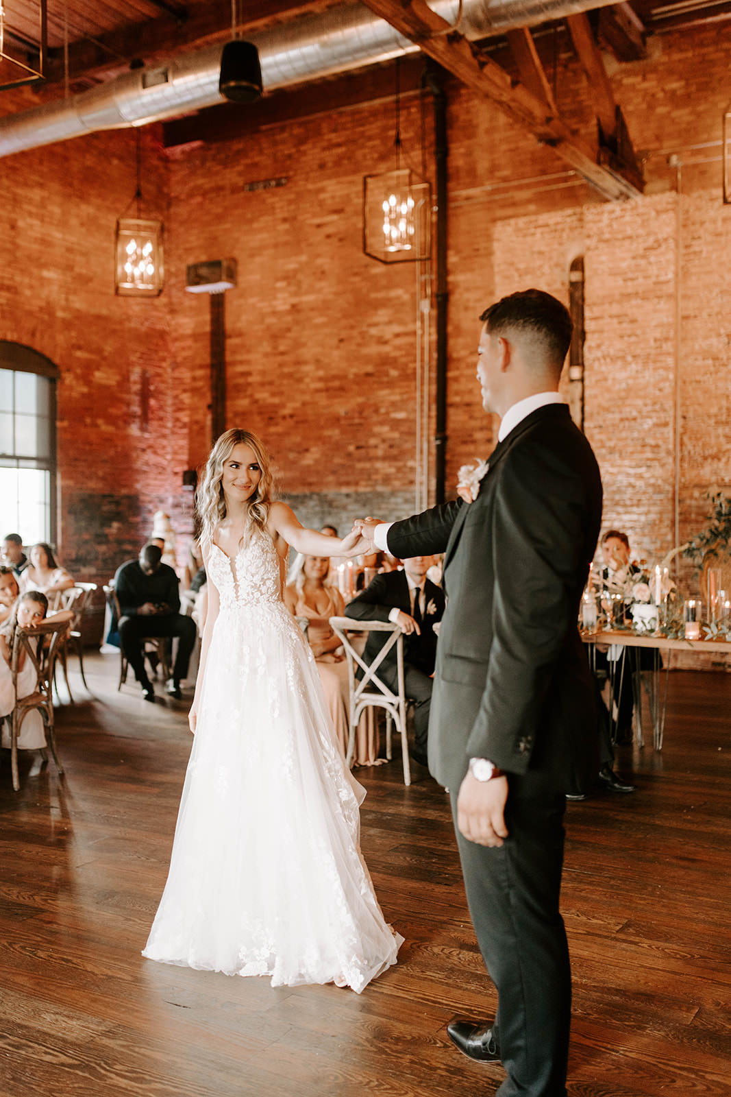 Romantic Boho Chic Bride and Groom First Dance Wedding Reception Portrait   Tampa Bay Wedding Industrial Venue Armature Works