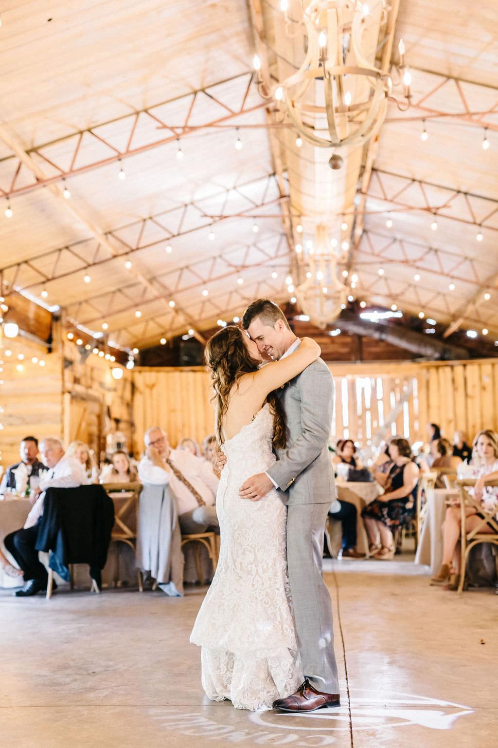 Tampa Bay Bride and Groom First Dance with String Lighting Wedding Reception Portrait   Plant City Outdoor Wedding Venue Florida Rustic Barn Weddings