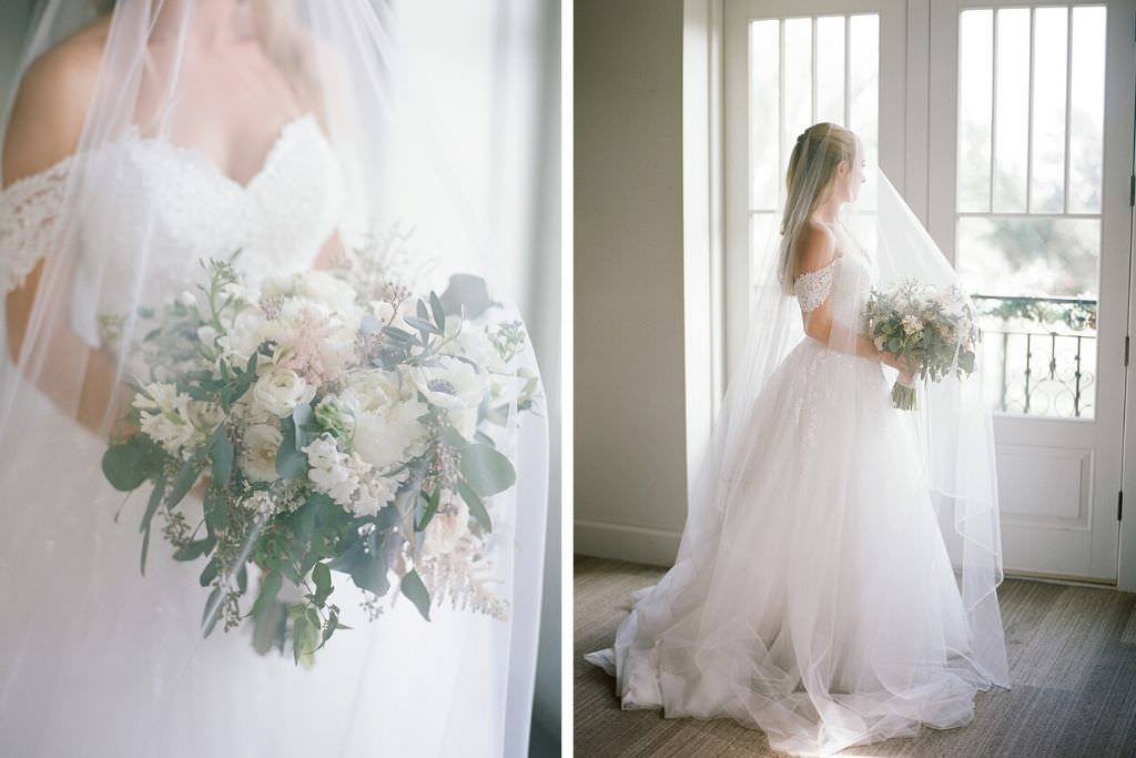 St. Petersburg Romantic Bride Beauty Wedding Portrait in Ballgown Floral Lace and Tulle Off the Shoulder Wedding Dress with Cathedral Veil Over Face Holding Garden Inspired White Roses, Anemone, Blush Pink Floral and Greenery Bridal Bouquet