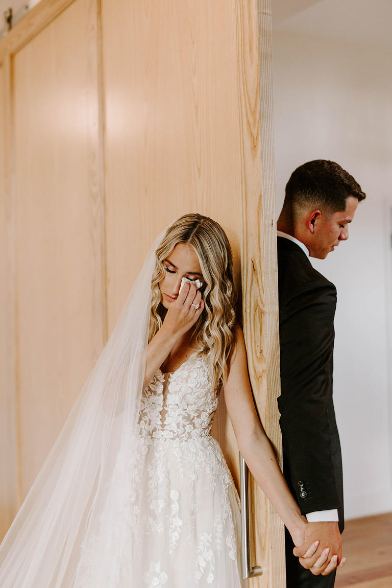 Emotional Tampa Bay Bride and Groom Holding Hands Before First Look Portrait, Bride in Whimsical Boho Lace and Tulle V Neck Martina Liana Wedding Dress and Cathedral Length Veil