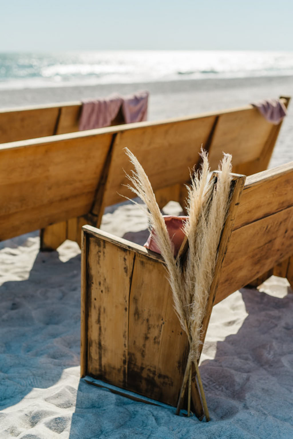 Longboat Key Club Beachfront Wedding Ceremony with Wooden Pews with Dry Beach Grass Aisle Decor | Resort at Longboat Key Club Waterfront Beach Wedding Venue