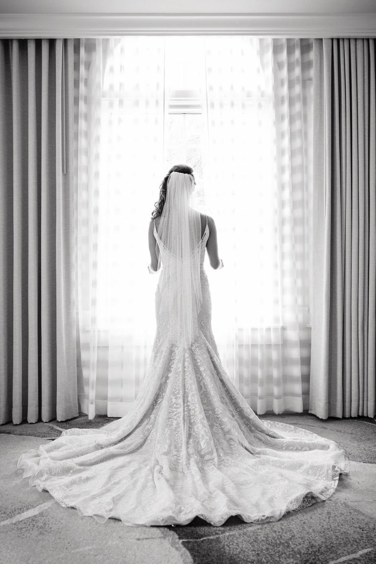 Florida Bridal Portrait Looking Out the Window, Hayley Paige Wedding Dress, Black and White Symmetrical | Tampa Bay Beachfront Resort The Don CeSar Hotel