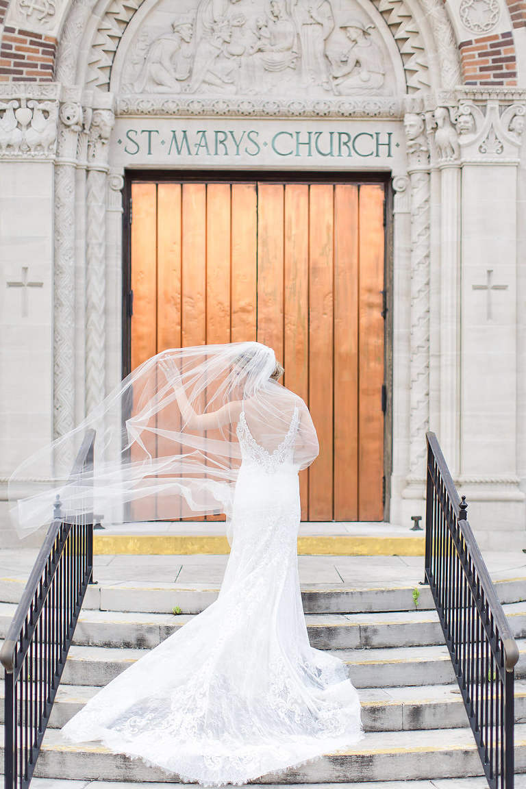 Tampa Bay Bride on Steps of Cathedral, at Saint Mary Our Lady of Grace Church, Allure Veil Blowing in Wind | St. Petersburg Wedding Photographers Shauna and Jordon Photography