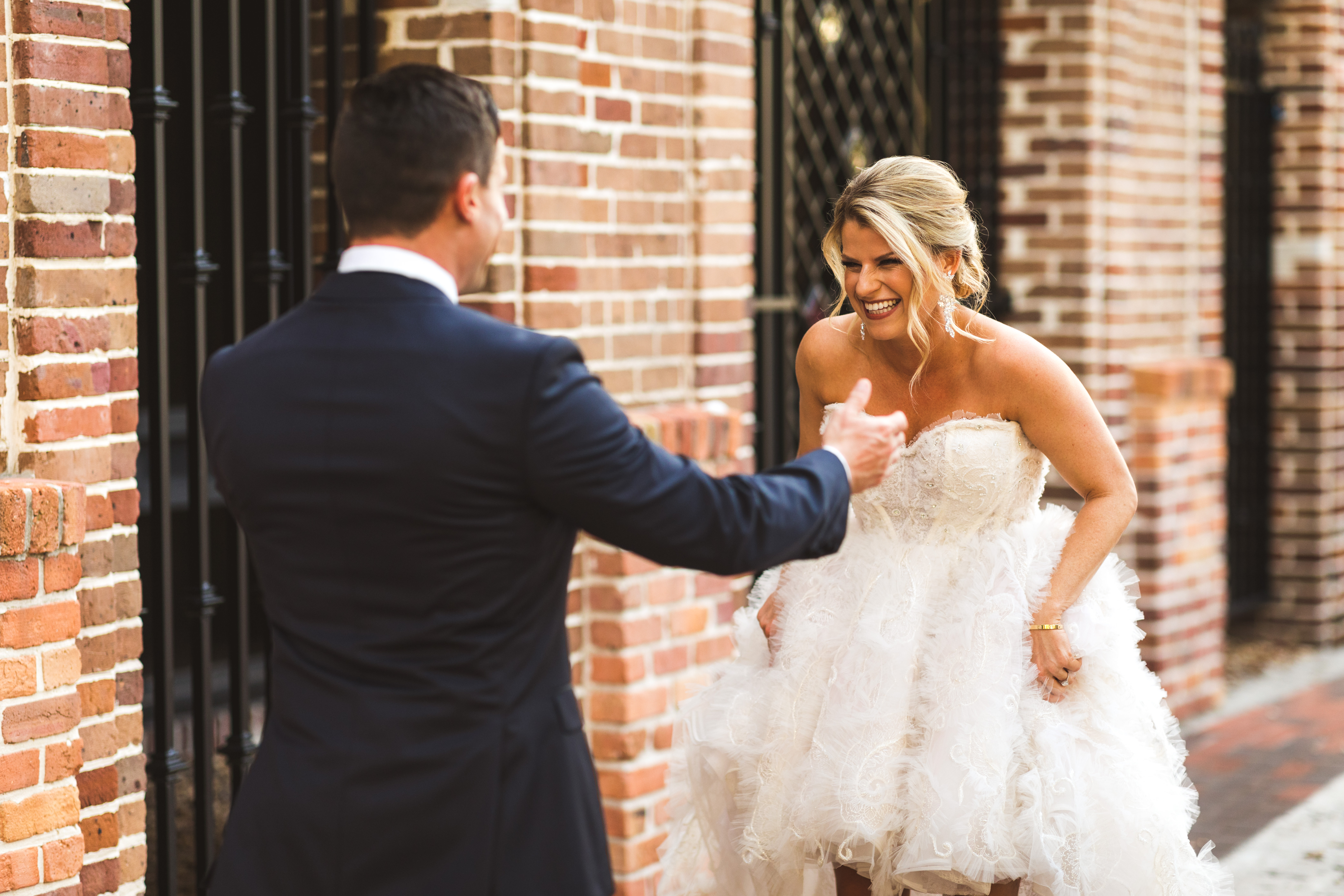 Fun Tampa Bay Bride and Groom Outdoor First Look Wedding Portrait   Wedding Dress Shop Isabel O'Neil Bridal Collection