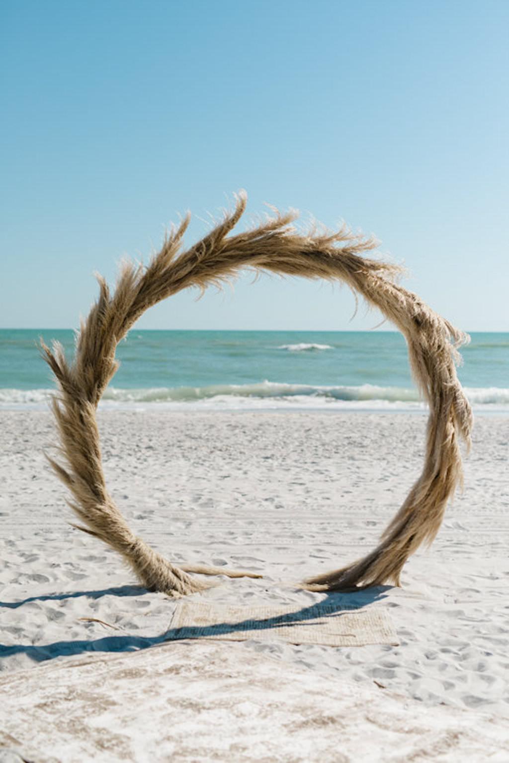 Longboat Key Club Beachfront Wedding Ceremony with Beach Grass Wedding Ceremony Arch | Resort at Longboat Key Club Waterfront Beach Wedding Venue