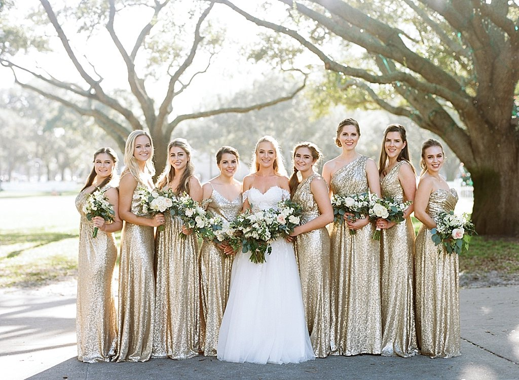 INSTAGRAM St. Pete Bride in Sweetheart Off the Shoulder Ballgown Wedding Dress, Bridesmaids in Randy Fenoli Sequin Gold Matching Dresses Holding Garden Inspired White and Greenery Floral Bouquets Bridal Party Wedding Portrait