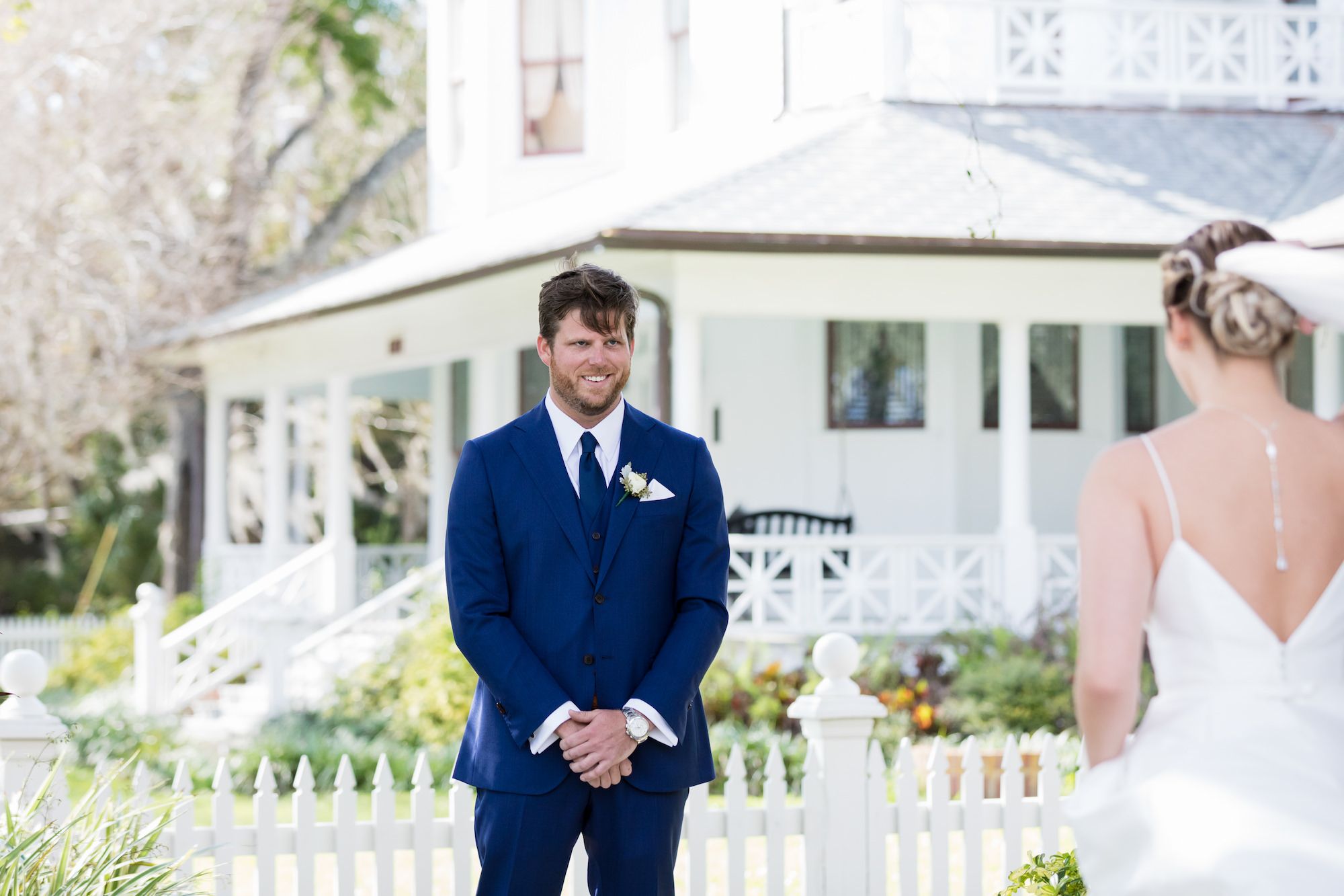 Tampa Bay Groom in Navy Blue Suit and Tie and Bride First Look Wedding Portrait