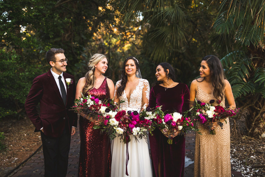 INSTAGRAM Boho Chic Tampa Bay Bride in Boho Chic Chiffon A-Line V Neck Illusion Long Sleeve with Lace Appliques Wedding Dress Holding Whimsical Colorful Pink, Purple and White Floral Bouquet, Bridesmaids in Mix and Match Dresses, Gold Sparkle, Burgundy Velvet, Red Sequins, Male Friend in Velvet Burgundy Suit | Tampa Bay Wedding Hair and Makeup Femme Akoi Beauty Studio