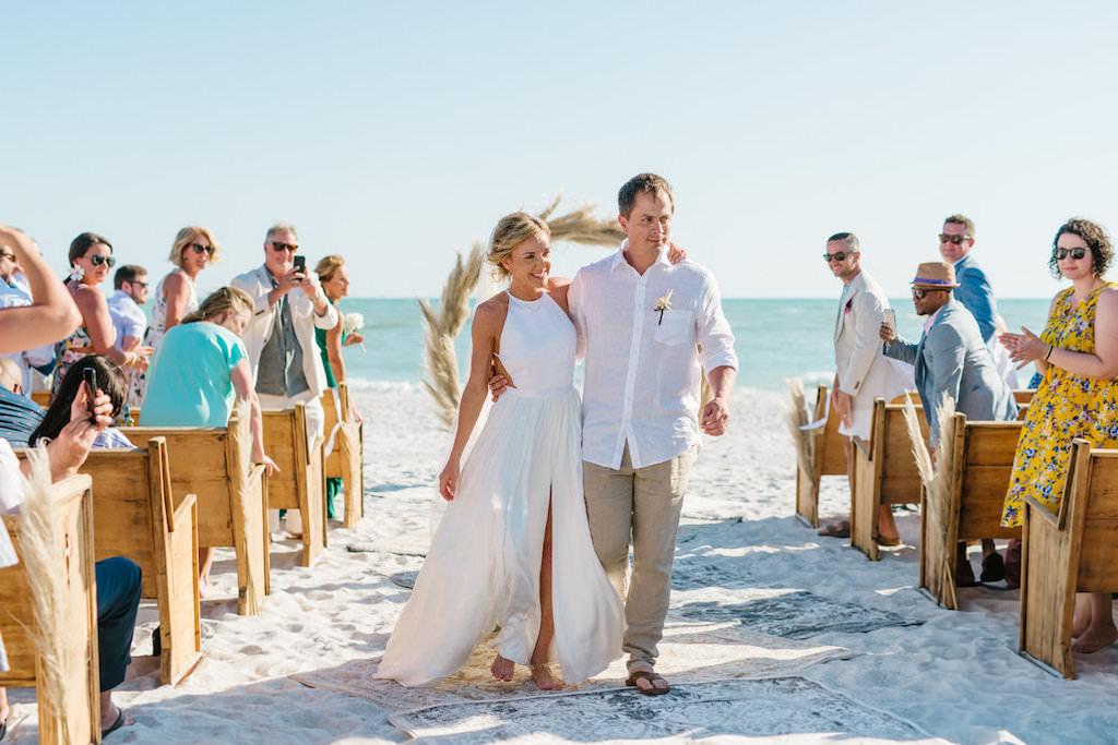 Longboat Key Club Beachfront Wedding Recessional Portrait of Bride and Groom | Resort at Longboat Key Club Waterfront Beach Wedding Venue